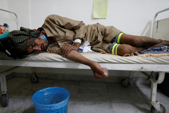 A man lies on the bed of a cholera treatment center in Sanaa, Yemen, May 15, 2017. Khaled Abdullah