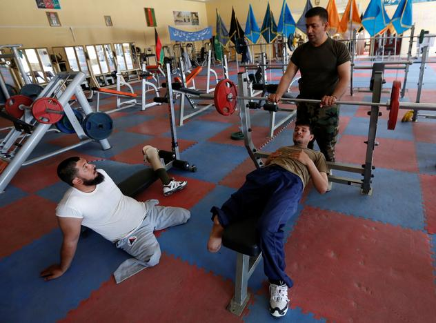 Wounded members of Afghanistan's National Army (ANA) talk to their trainer's during a practice for Invictus Games competition, at the Kabul Military Training Centre (KMTC) in Kabul, Afghanistan July 4, 2017. Mohammad Ismail