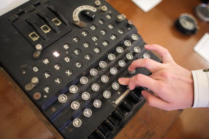 An employee of an auction house presses a key on an working original Enigma cipher machine that is on display at an auction house in Bucharest, Romania, July 11, 2017. Inquam Photos/Octav Ganea/