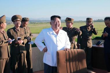 North Korean leader Kim Jong Un watches the test of a new-type...