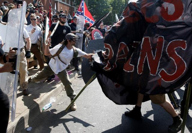 White nationalists clash with counter protesters at a rally in Charlottesville. REUTERS/Joshua Roberts