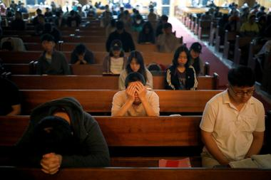 Students pray during an early-morning prayer session at the Presbyterian...