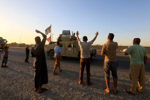 Iraqi forces advance on Kurdish-held area