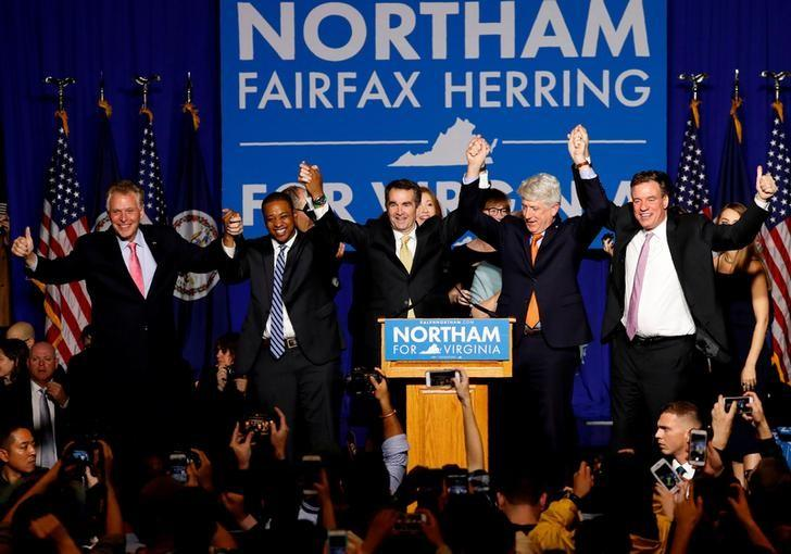 Virginia Governor-Elect Ralph Northam, center, celebrates with other elected officials, at his election night rally in Fairfax, Virginia, November 7, 2017. Aaron P. Bernstein