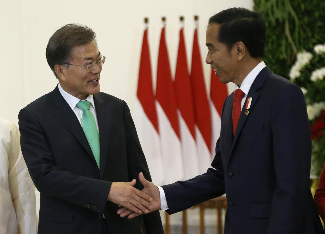 South koreas moon unveils new focus on southeast asia south korean president moon jae in is greeted by his indonesian counterpart joko widodo during their meeting at the presidential palace in bogor west java m4hsunfo