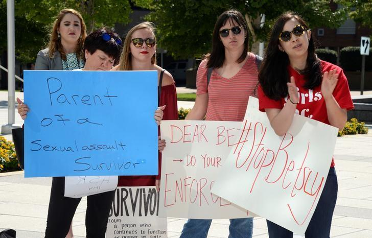 A group of protesters outside Education Secretary Betsy DeVos's policy address changing federal guidelines on college rape and sexual assault, at George Mason University, in Arlington, Virginia, U.S., September 7, 2017. Mike Theiler