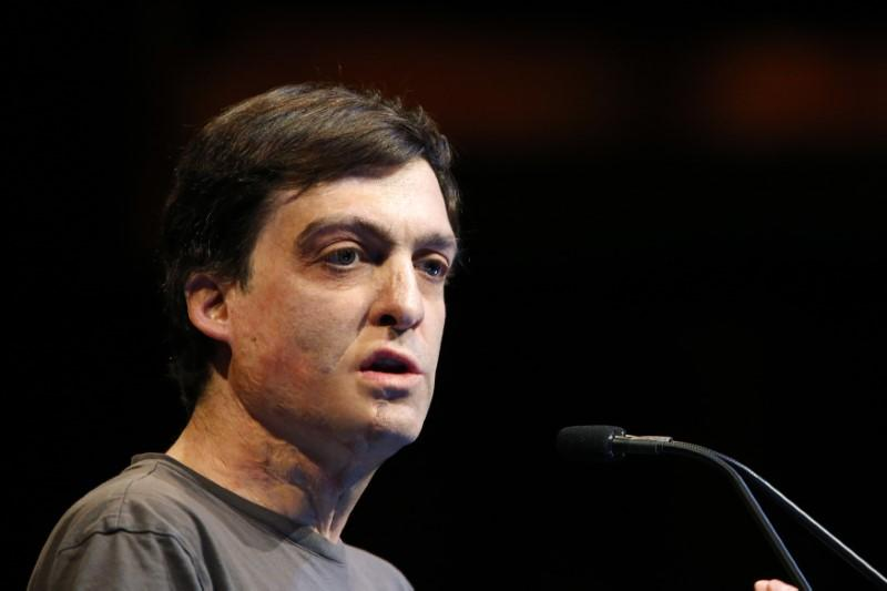 Dan Ariely, professor of psychology and behavioral economics, speaks at the Sohn Investment Conference in New York, May 5, 2014.  Eduardo Munoz