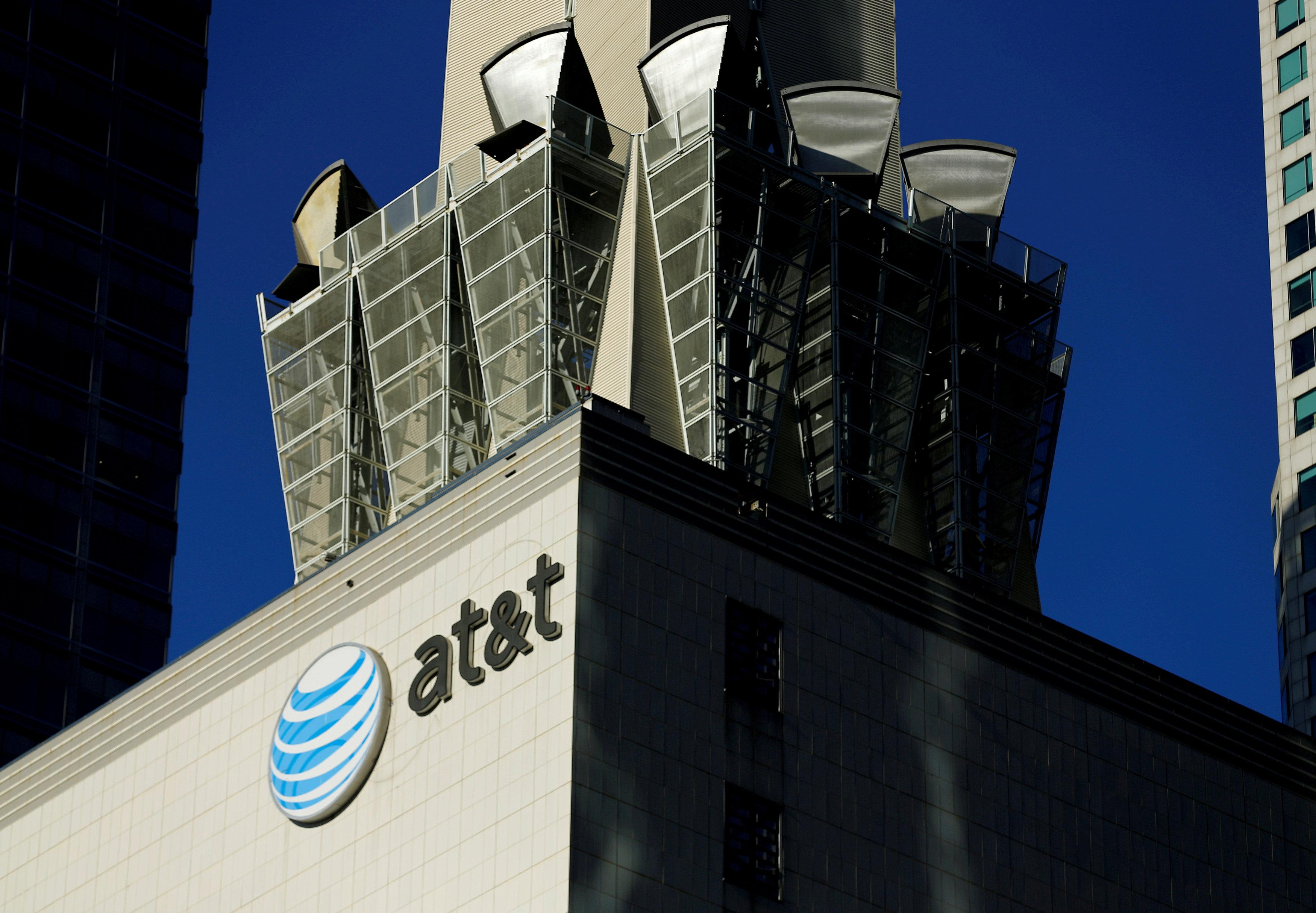 An AT&T logo and communication equipment is shown on a building in downtown Los Angeles, California October 29, 2014.    Mike Blake