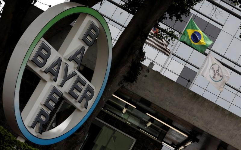 The Brazilian national flag is seen next to Bayer