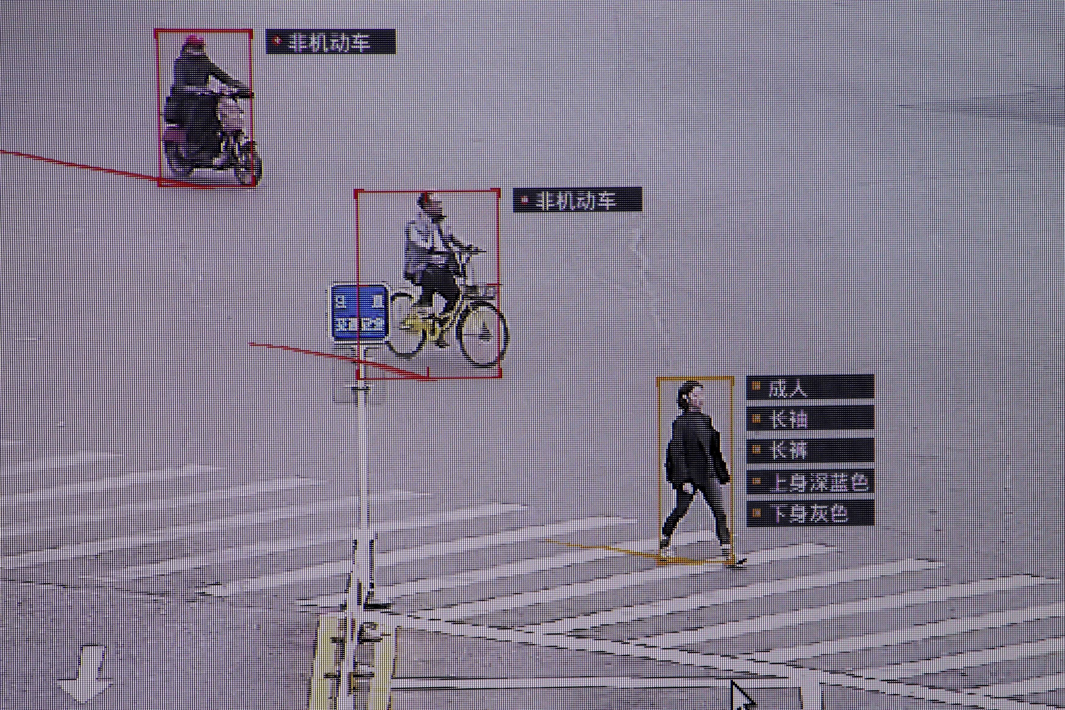 SenseTime surveillance software identifying details about people and vehicles runs as a demonstration at the company's office in Beijing, China, October 11, 2017.    Thomas Peter