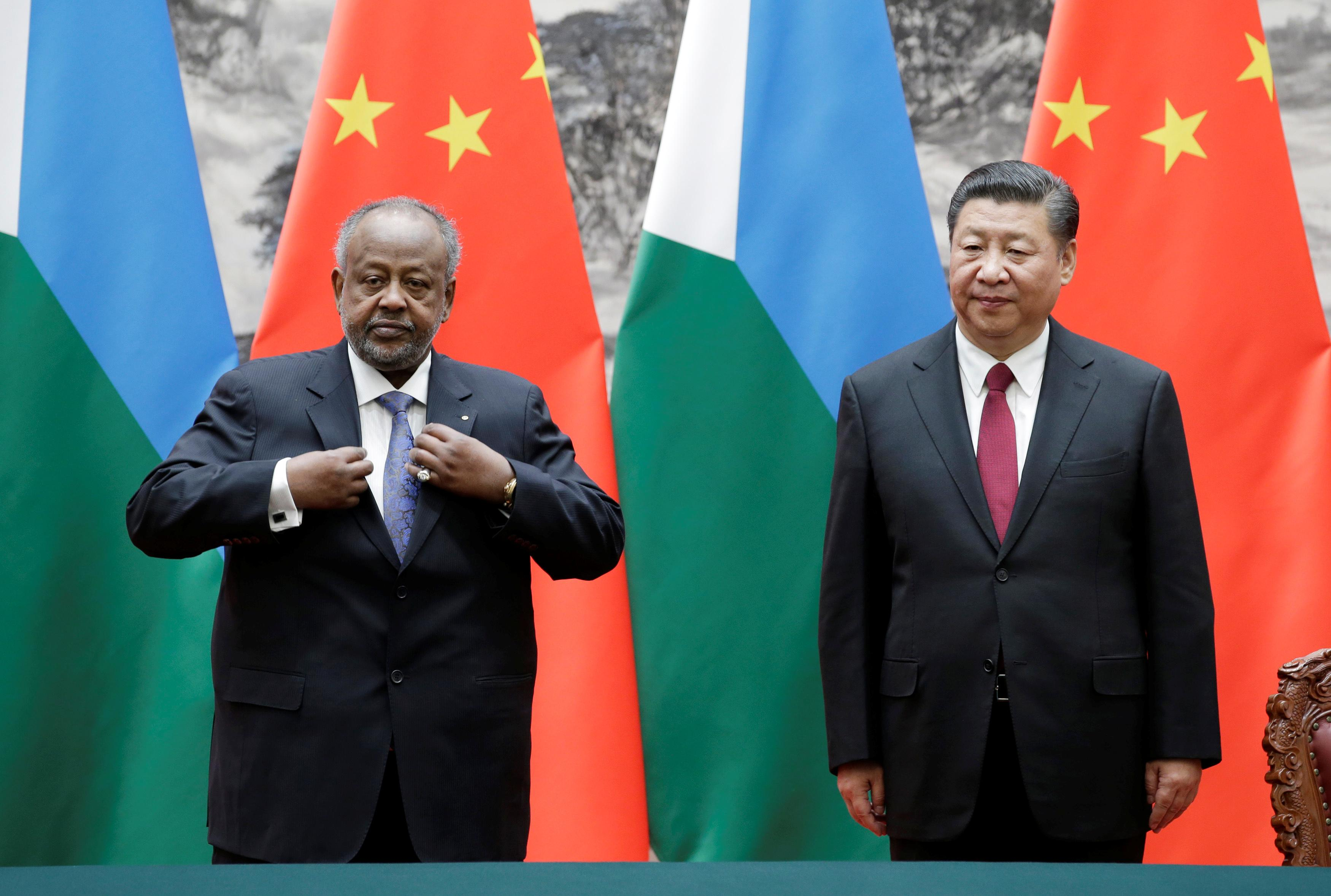 Chinese President Xi Jinping and Djibouti's President Ismail Omar Guelleh attend a signing ceremony at the Great Hall of the People in Beijing, China November 23, 2017. Jason Lee