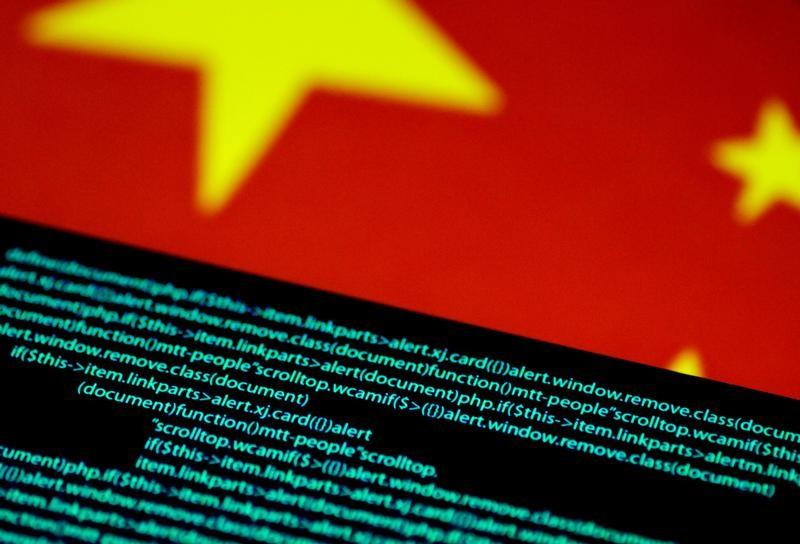 Computer code is seen on a screen above a Chinese flag in this July 12, 2017 illustration photo.   Thomas White/Illustration