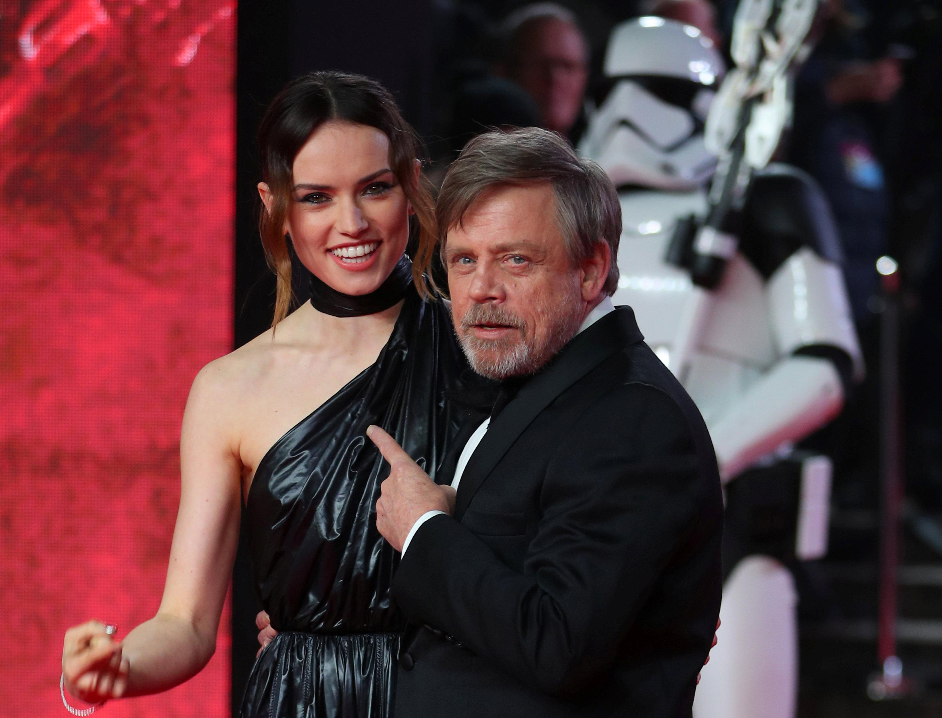 Actors Daisy Ridley and Mark Hamill pose for photographers as they arrive for the European Premiere of 'Star Wars: The Last Jedi', at the Royal Albert Hall in central London, Britain December 12, 2017. Hannah McKay