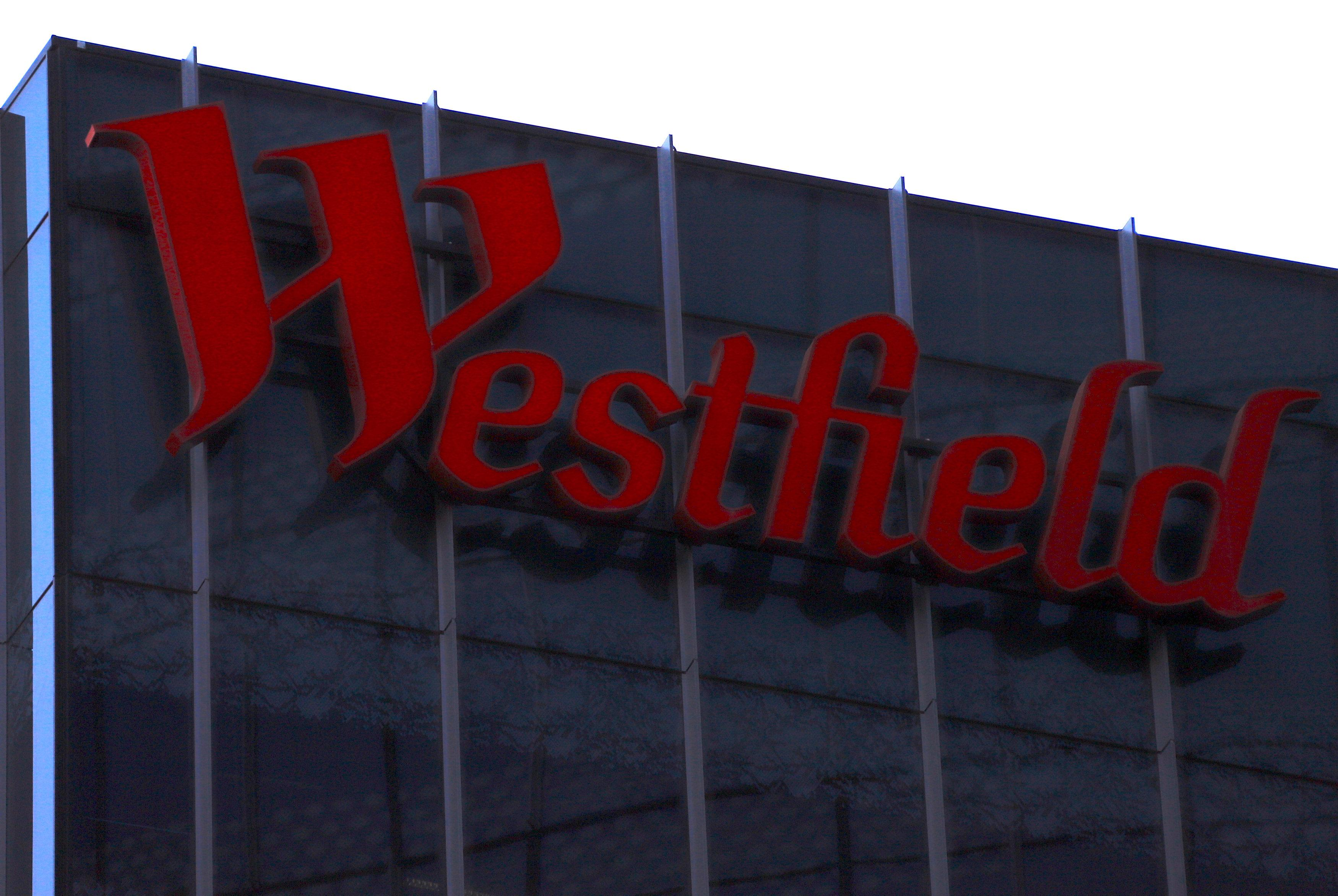 A Westfield Corp sign adorns the side of a building in central Sydney, Australia, December 12, 2017.      David Gray