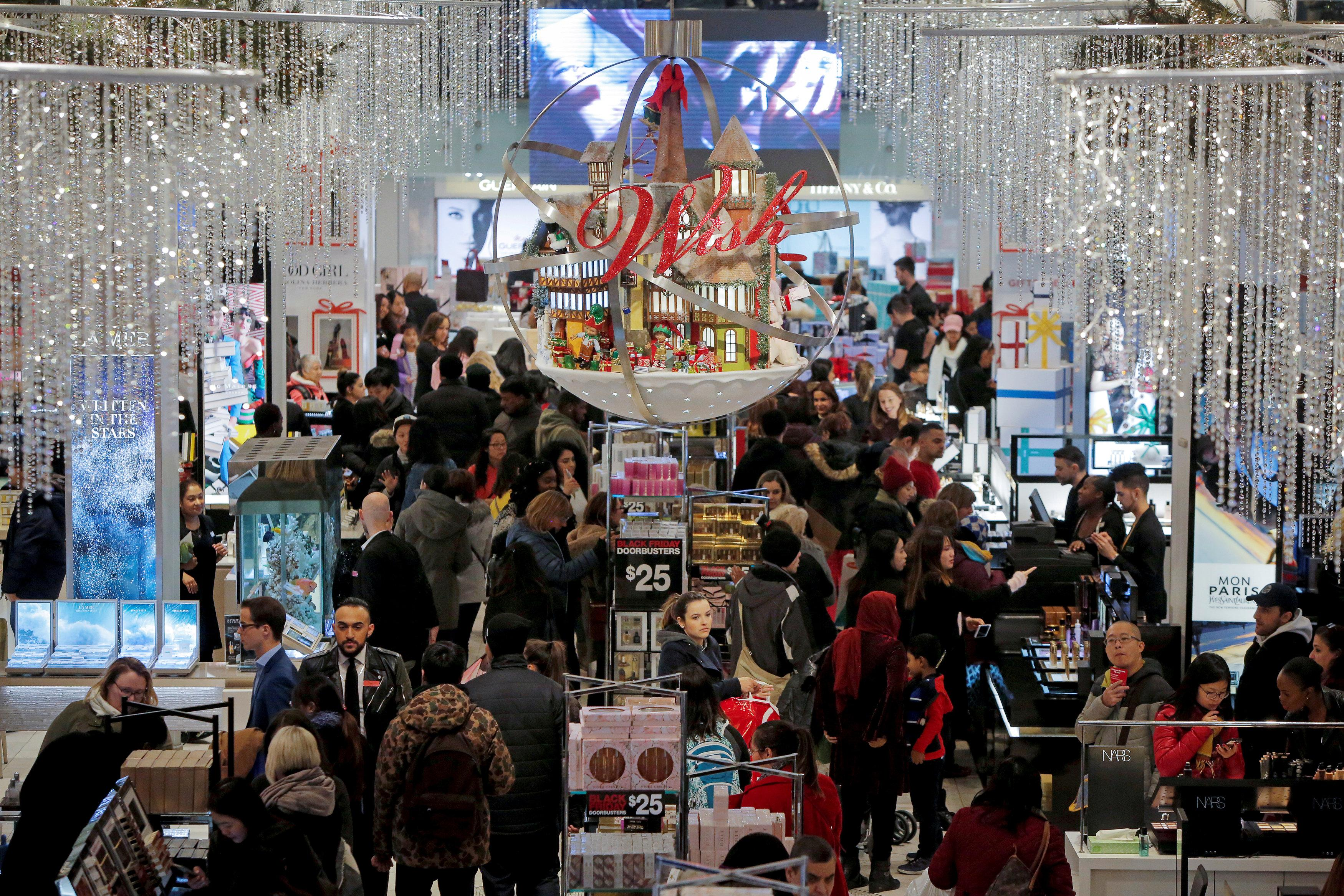 People shop in Macy's Herald Square during early opening for the Black Friday sales in Manhattan, New York, U.S., November 23, 2017.  Andrew Kelly