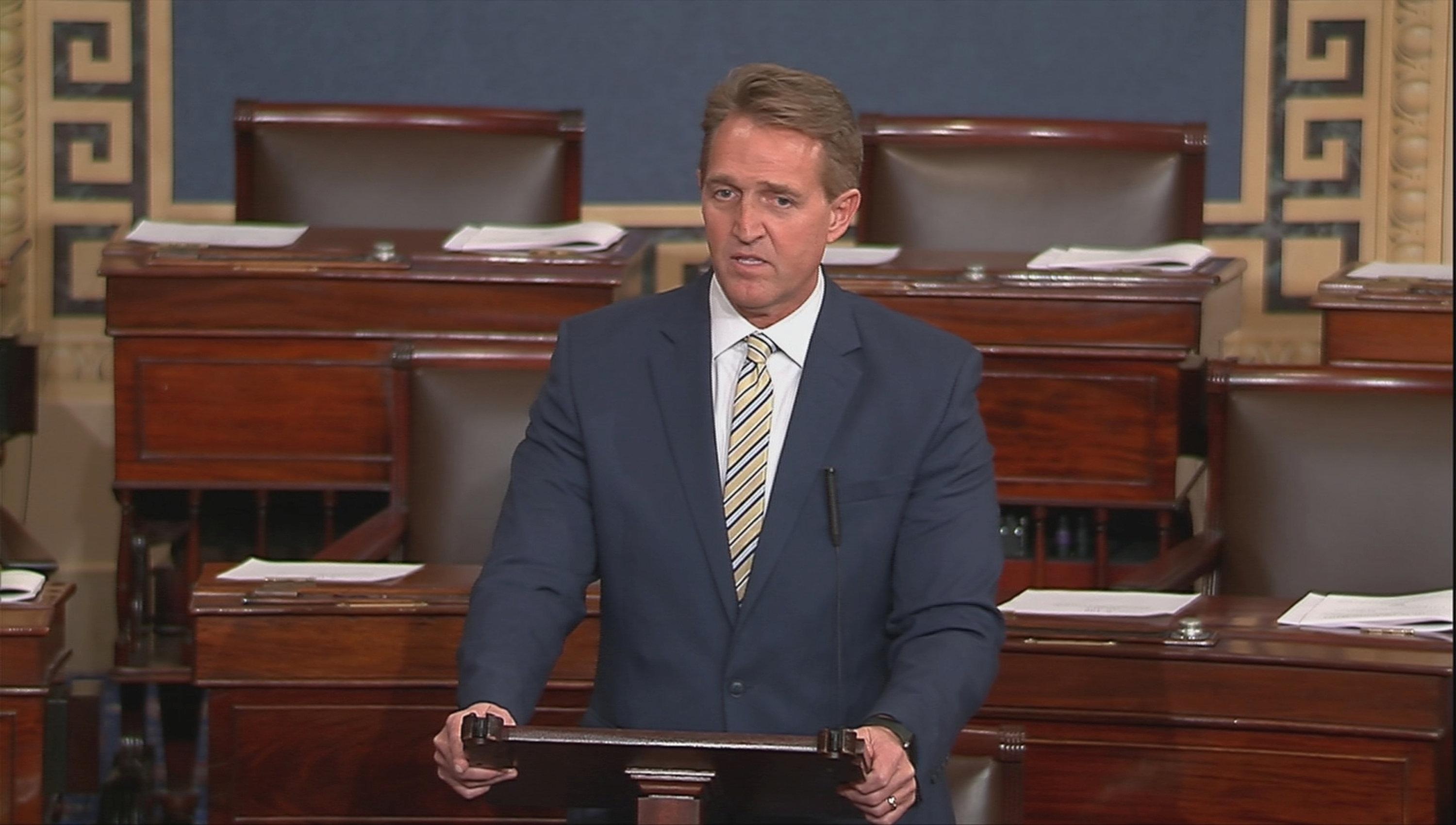 U.S. Senator Jeff Flake (R-AZ)  speaks on the Senate floor in this still image taken from video on Capitol Hill in Washington, U.S., January 17, 2018. Senate TV via Reuters/Handout