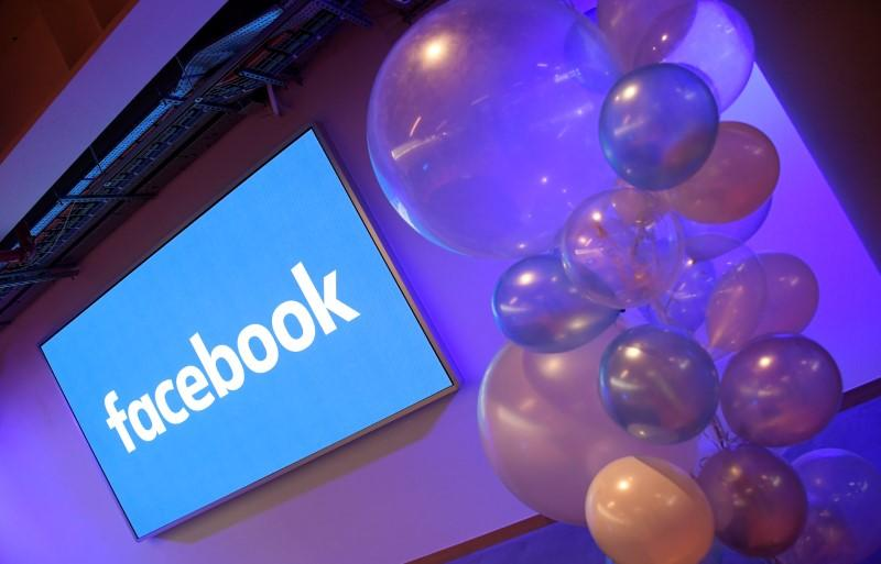 Balloons are seen in front of a logo at Facebook's headquarters in London, Britain, December 4, 2017. Toby Melville - RC1AE21EBF40