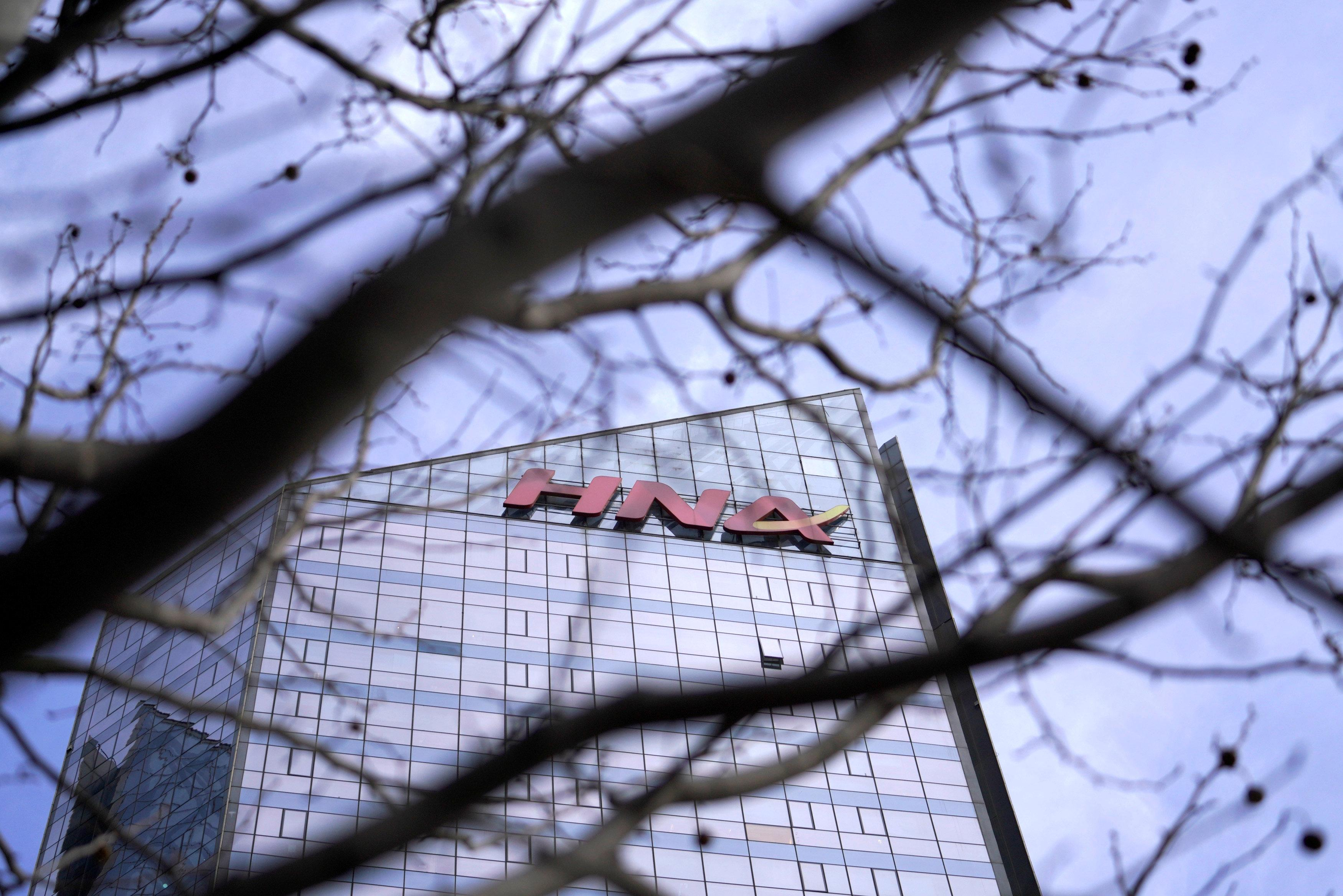 A HNA Group logo is seen on the building of HNA Plaza in Beijing, China February 9, 2018.  Jason Lee