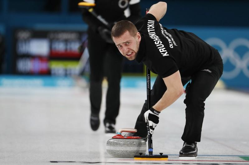 Curling – Pyeongchang 2018 Winter Olympics – Mixed Doubles Bronze Medal Match - Olympic Athletes from Russia v Norway - Gangneung Curling Center - Gangneung, South Korea – February 13, 2018 - Alexander Krushelnitsky, an Olympic athlete from Russia, sweeps. Picture taken February 13, 2018. Cathal McNaughton