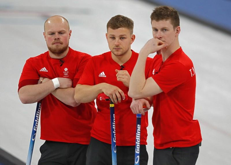 Curling - Pyeongchang 2018 Winter Olympics - Men's Round Robin - Britain v U.S. - Gangneung Curling Center - Gangneung, South Korea - February 21, 2018 -  Cameron Smith, Kyle Waddell and Thomas Muirhead of Britain react after losing to the U.S. Phil Noble
