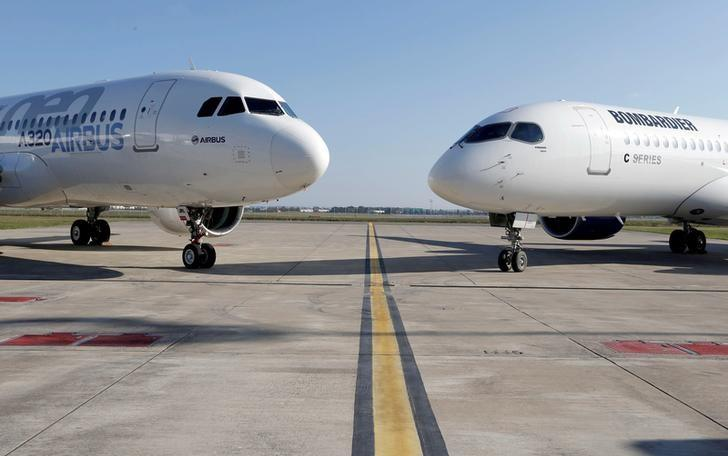An Airbus A320neo aircraft and a Bombardier CSeries aircraft are pictured during a news conference to announce a partnership between Airbus and Bombardier on the C Series aircraft programme, in Colomiers near Toulouse, France, October 17, 2017. Picture taken October 17, 2017.    Regis Duvignau