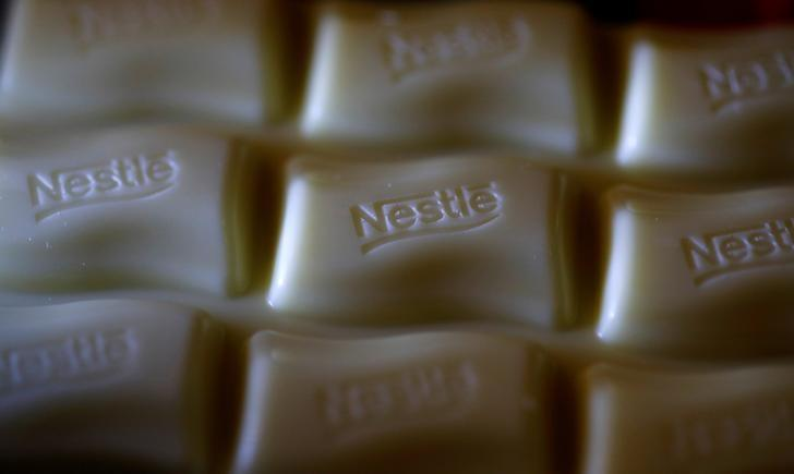 A Nestle company logo is pictured on a bar of Milky Bar chocolate in Manchester, Britain April 25, 2017. Phil Noble