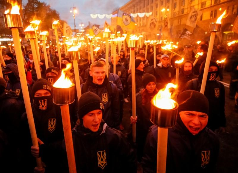 Supporters of Ukrainian nationalist and far-right groups take part in a rally to mark Defender of Ukraine Day in Kiev, October 14, 2017.  Gleb Garanich