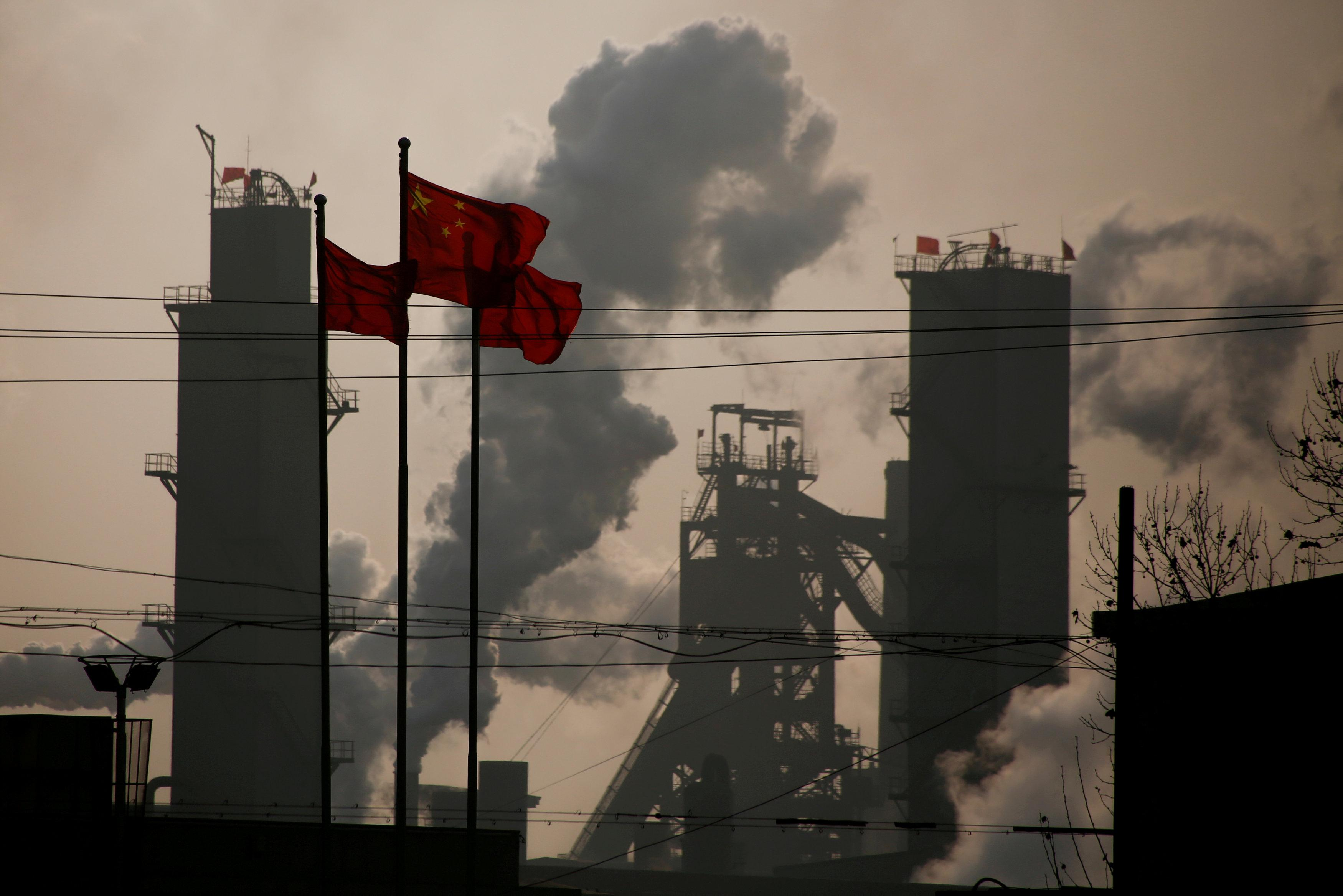 Chinese national flags are flying near a steel factory in Wu'an, Hebei province, China, February 23, 2017.  Thomas Peter