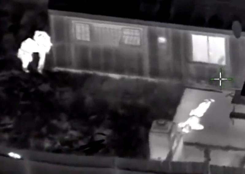 Stephon Clark, 22, is visible on the ground after two police officers (L) shot him, in this still image captured from police aerial video footage released by Sacramento Police Department, California, U.S., on March 21, 2018.   Courtesy Sacramento Police Department/Handout via