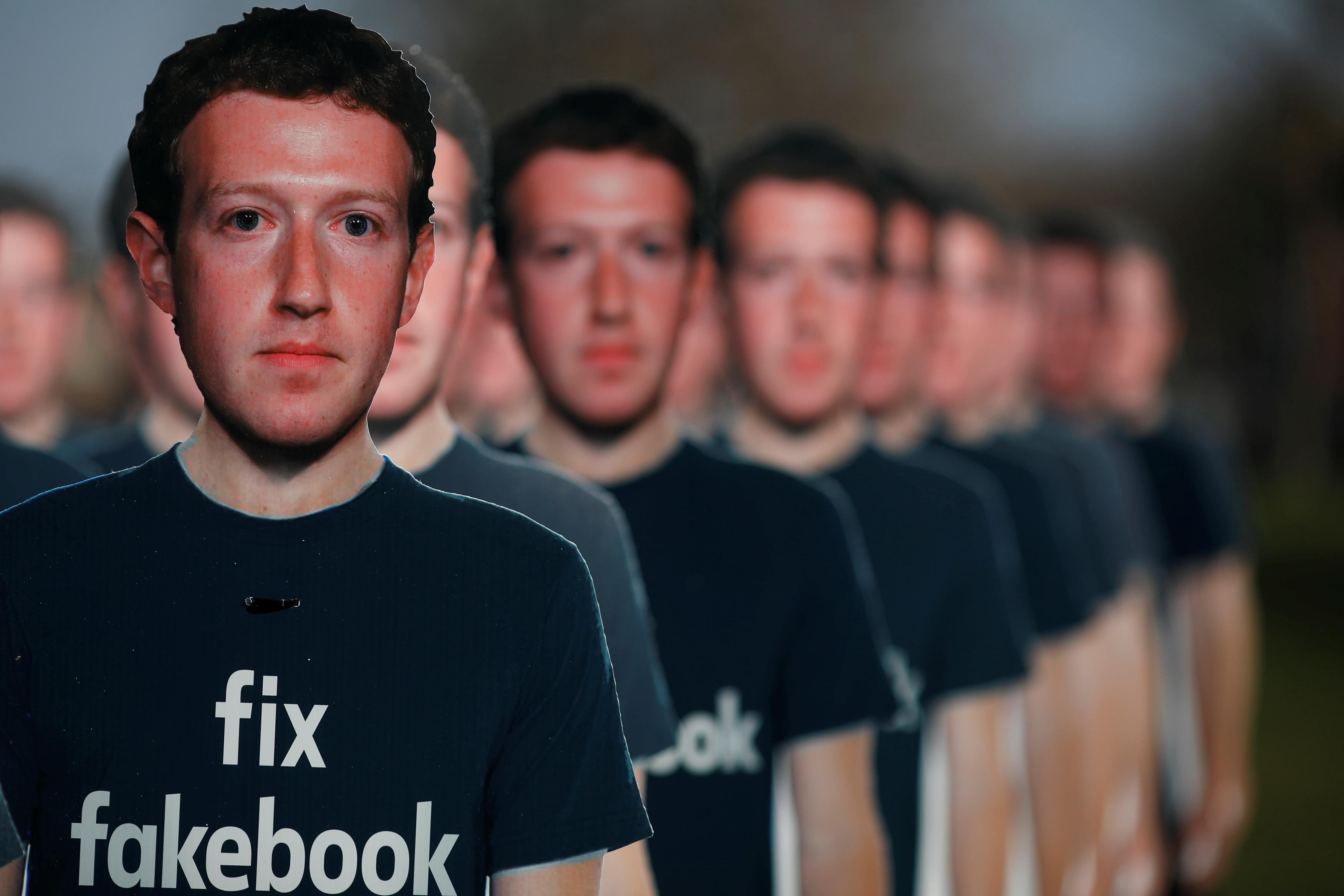 Dozens of cardboard cutouts of Facebook CEO Mark Zuckerberg are seen during an Avaaz.org protest outside the U.S. Capitol in Washington, U.S., April 10, 2018. Aaron P. Bernstein