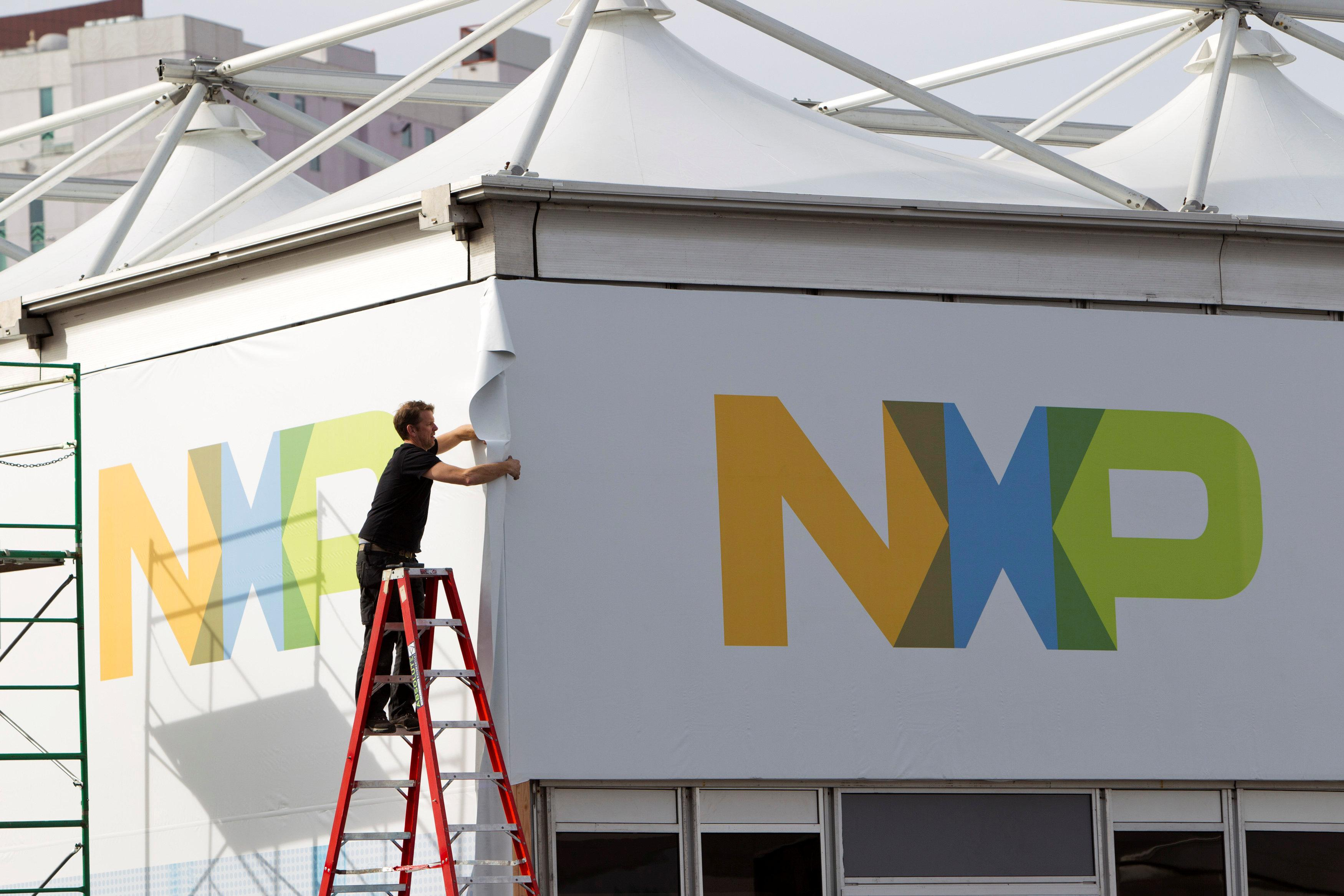 A man works on a tent for NXP Semiconductors in preparation for the 2015 International Consumer Electronics Show (CES) at Las Vegas Convention Center in Las Vegas, Nevada, U.S. January 4, 2015. Steve Marcus