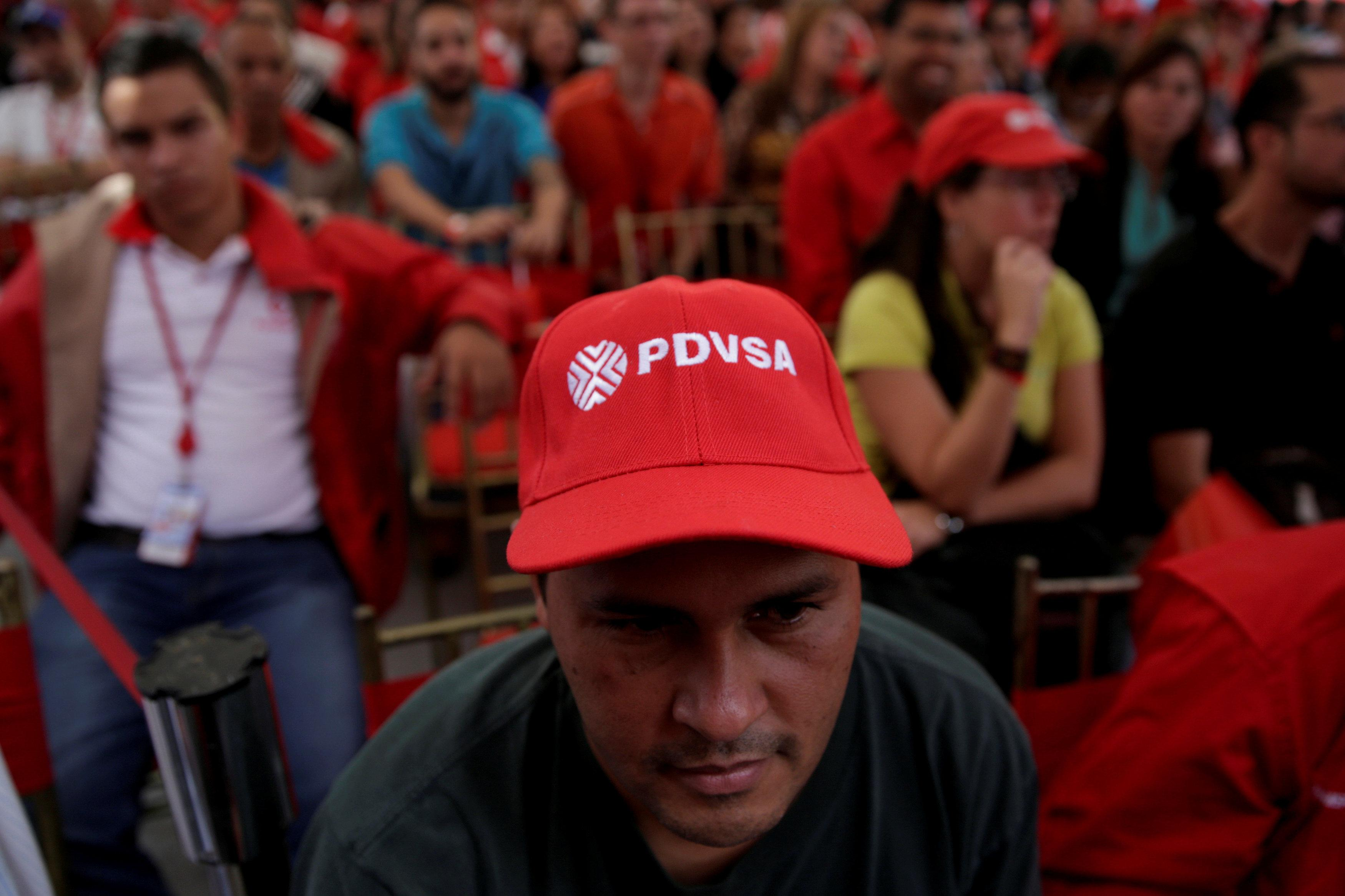 A man wears a cap with the logo of PDVSA as he attends the swear-in ceremony of the new board of directors of Venezuelan state oil company PDVSA in Caracas, Venezuela January 31, 2017. Marco Bello