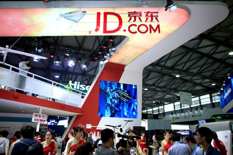 A sign of China's e-commerce company JD.com is seen at CES (Consumer Electronics Show) Asia 2016 in Shanghai, China, May 12, 2016. Aly Song