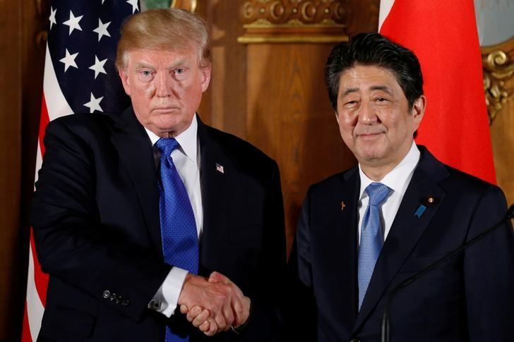 U.S. President Donald Trump and Japan's Prime Minister Shinzo Abe shake hands at the end of a news conference at Akasaka Palace in Tokyo, Japan, November 6, 2017. Jonathan Ernst