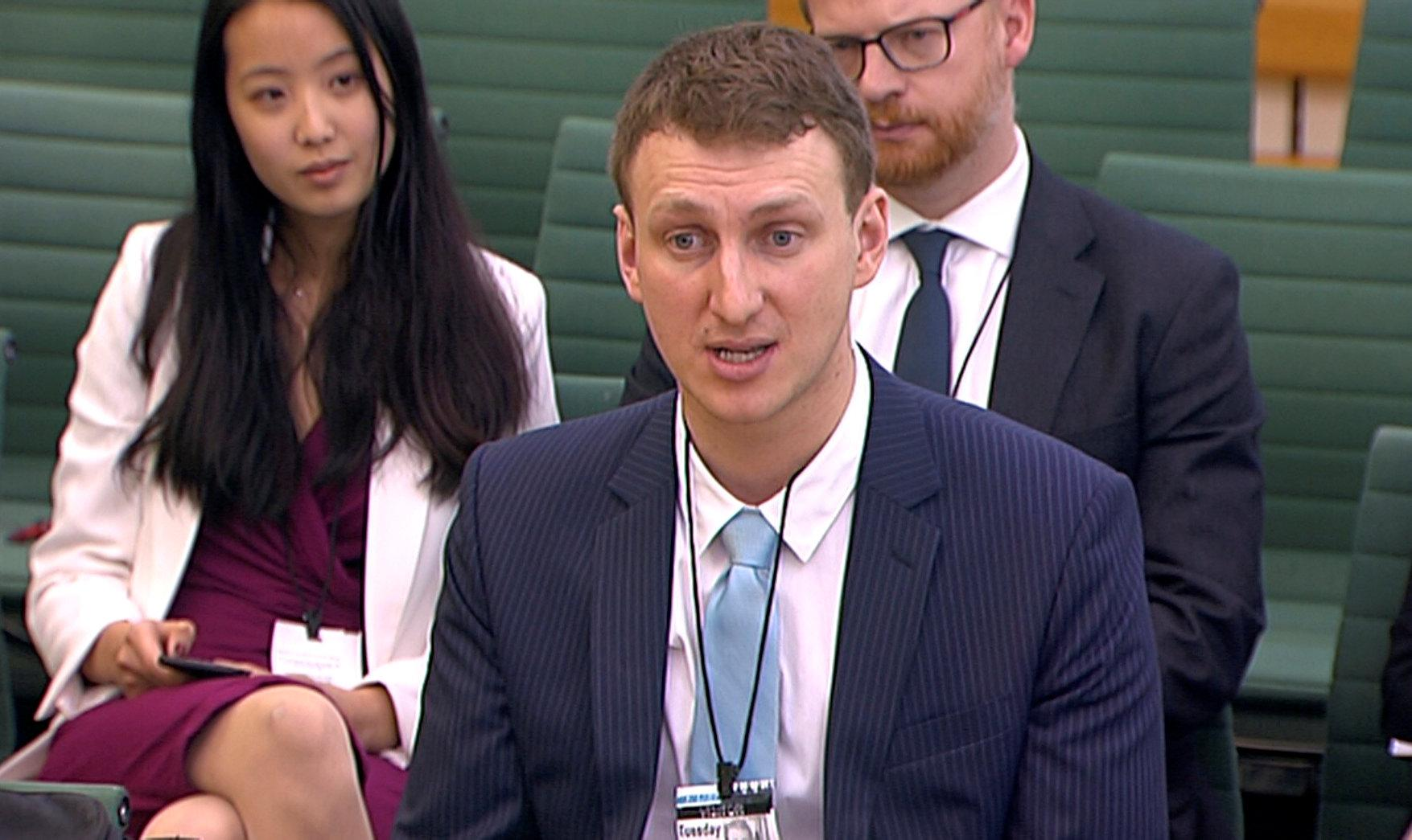 Aleksandr Kogan, a researcher at Cambridge University who created a personality quiz to collect users data on Facebook, gives evidence to Parliament's Digital, Culture, Media and Sport committe in Westminster, London, Britain, April 24, 2018. Parliament TV handout via