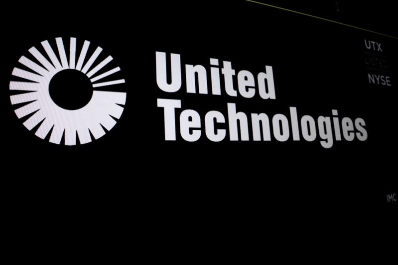 United Technologies logo is displayed on a screen at the post where it's stock is traded on the floor of the New York Stock Exchange (NYSE) in New York, U.S., September 5, 2017. Brendan McDermid