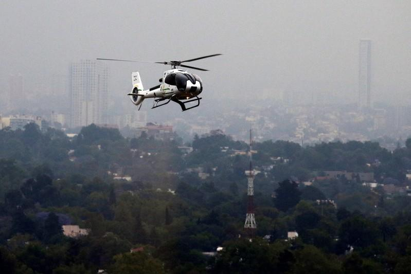 A helicopter booked through the app Voom arrives for a client to a helipad in Mexico City, Mexico April 24, 2018. Tomas Bravo