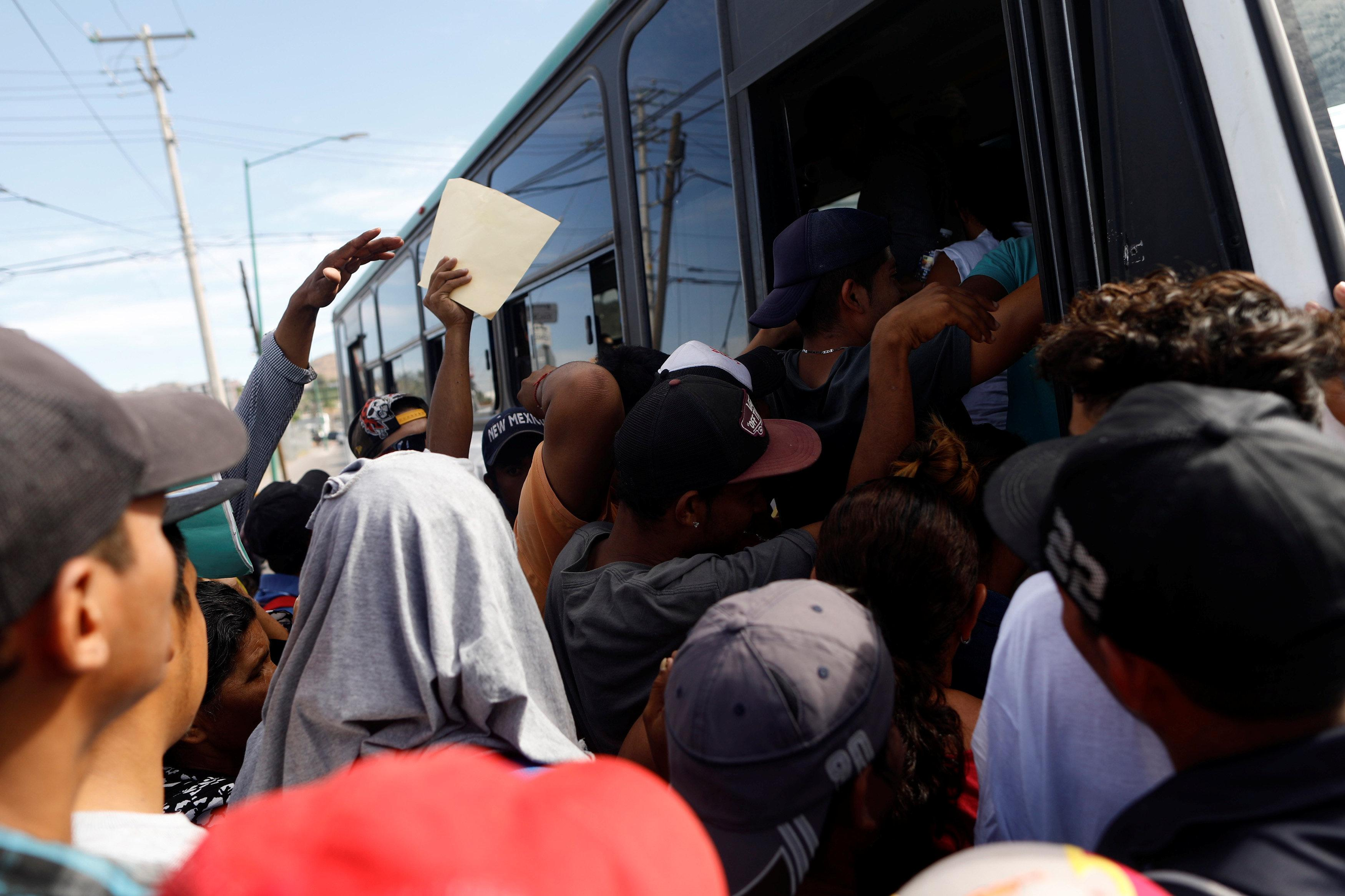 A group of Central American migrants, moving in a caravan through Mexico, get on a microbus to get to the office of Mexico's National Institute of Migration to start the legal process and get temporary residence status for humanitarian reasons, in Hermosillo, Sonora state, Mexico April 24, 2018. Edgard Garrido