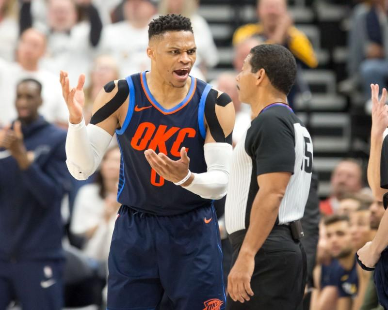 Apr 23, 2018; Salt Lake City, UT, USA; Oklahoma City Thunder guard Russell Westbrook (0) argues with referee Bill Kennedy (55) during the first half of game four of the first round of the 2018 NBA Playoffs against the Utah Jazz at Vivint Smart Home Arena. Mandatory Credit: Russ Isabella-USA TODAY Sports