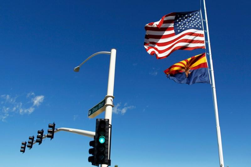 The U.S. and Arizona flags flutter in the wind in Fountain Hills, Arizona, U.S. on September 30, 2016.    Ricardo Arduengo