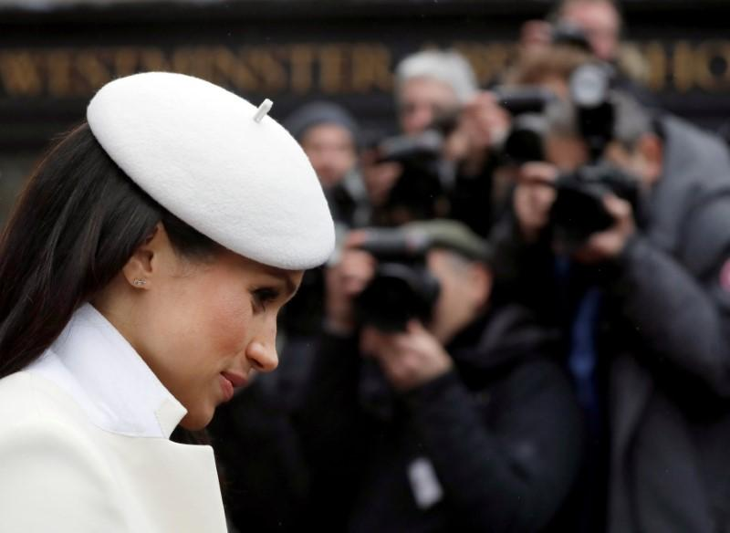 Meghan Markle leaves Westminster Abbey after attending the Commonwealth Service in London, March 12, 2018. Kirsty Wigglesworth/Pool