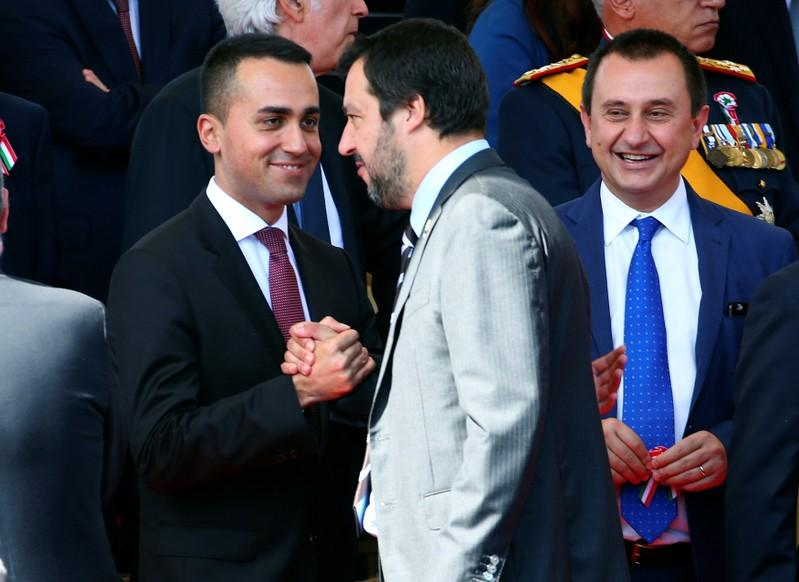 Italian Labor Minister Luigi Di Maio shakes hands with Interior Minister Matteo Salvini at the Republic Day military parade in Rome. June 2, 2018. Tony Gentile