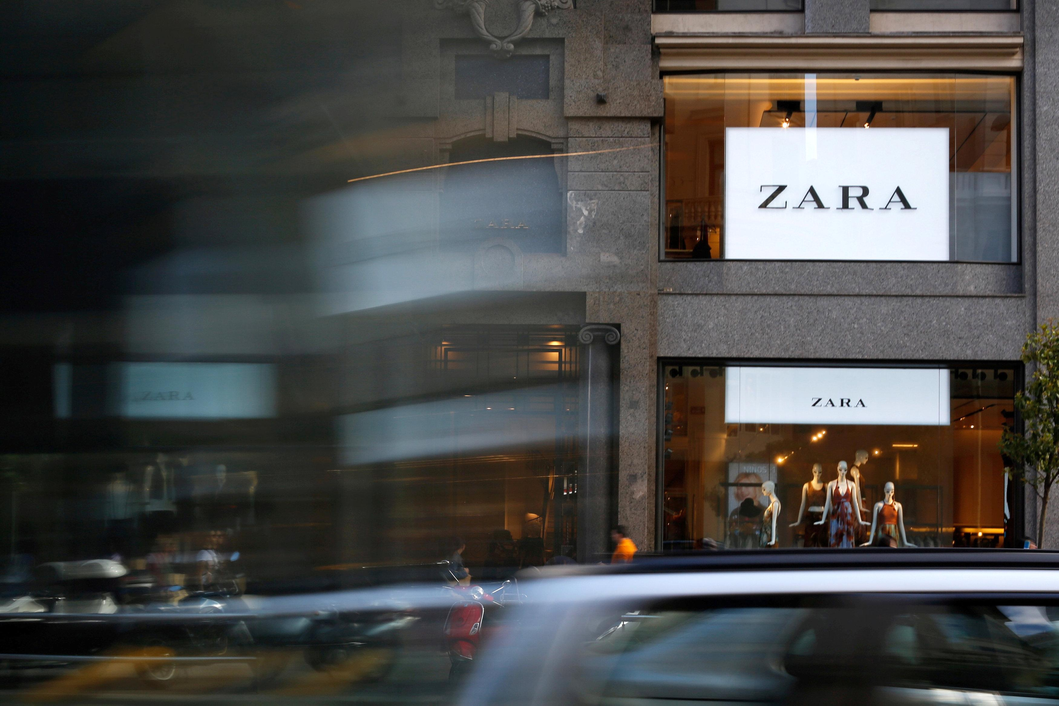 Cars pass in front of a Zara store in Madrid, Spain, June 15, 2016.   Paul Hanna