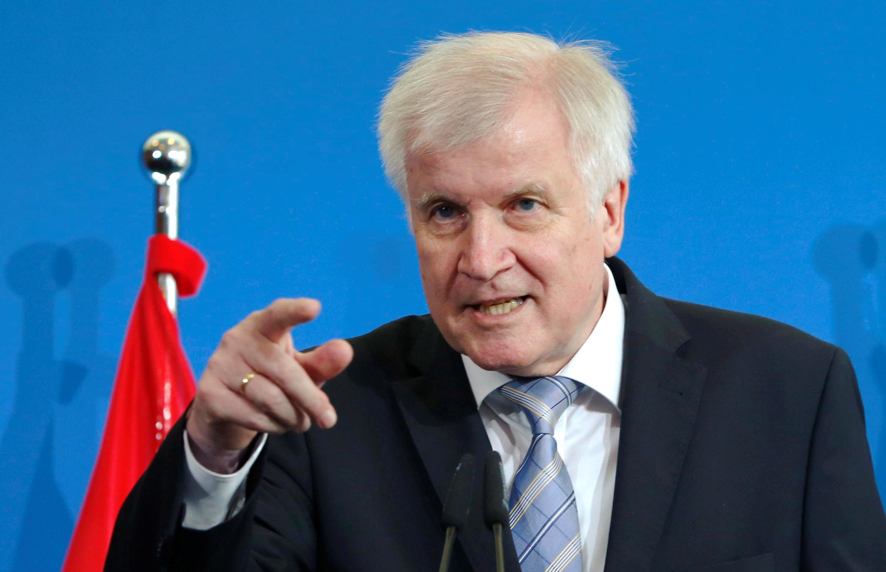 German Interior Minister Horst Seehofer gestures as he attends a news conference with Austria's chancellor Sebastian Kurz in Berlin, Germany, June 13, 2018. Joachim Herrmann