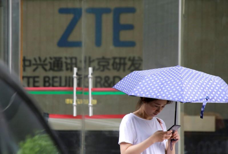 A woman stands outside a building of ZTE Beijing research and development center in Beijing, China June 13, 2018. Jason Lee