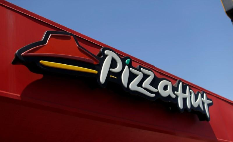 The sign at a Pizza Hut location, which is owned by Yum Brands Inc, is pictured ahead of their company results in Pasadena, California U.S., July 11, 2016. Mario Anzuoni