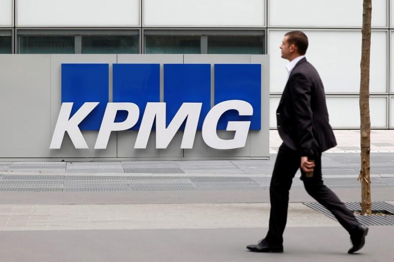 The logo of KPMG, a professional service company, is seen at the company
