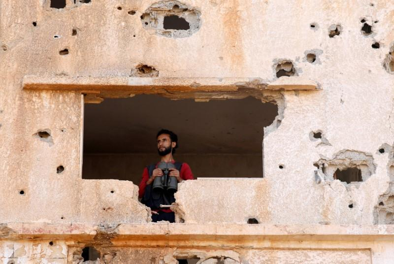 A fighter from the Free Syrian Army is seen in Yadouda area in Deraa, Syria May 29, 2018. Alaa Al-Faqir