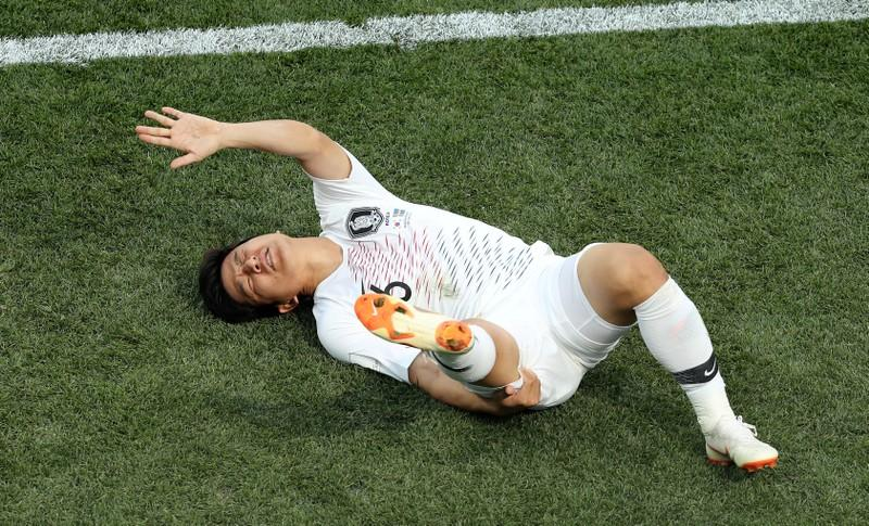 South Korea's Park Joo-ho lies on the pitch injured in the World Cup Group F match against Sweden on June 18, 2018 in Nizhny Novgorod.   Lucy Nicholson
