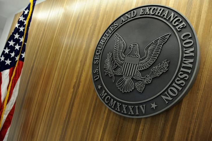 The seal of the U.S. Securities and Exchange Commission hangs on the wall at SEC headquarters in Washington, U.S., June 24, 2011.  Jonathan Ernst